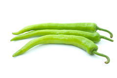 Three green chili peppers. Isolated on the white background Stock Photography
