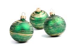 Three green christmas balls Stock Photography