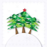Three green Christmas fir trees on the hill on white background. Stock Photo
