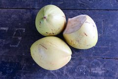 Three green coconuts on an old table. Emotional recordings from the tropical paradise of Seychelles in the Indian Ocean off Africa Stock Photography