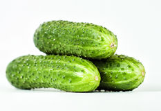 Three green cucumber Royalty Free Stock Images