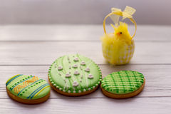 Three green easter cookies with a chik Royalty Free Stock Photos