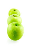 Three green fresh apples. Isolated on white background stock photography