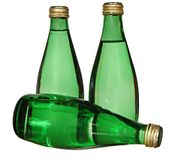 Three green glass bottles isolated on white background Royalty Free Stock Photos