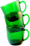 Three Green Glass Punch Cups Isolated. Three colorful green glass cups isolated on a white background royalty free stock image