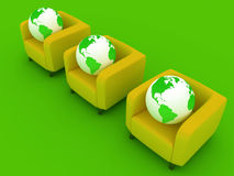 Three green Globes and sofa Stock Photo