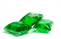 Three green laundry detergent capsules Stock Image