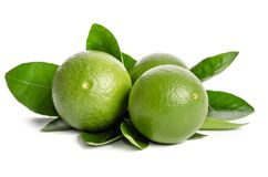Three green limes with leaves. On white background Stock Photos