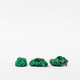 Three green malachite minerals Stock Photography