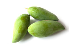 Three green mango. Three Whole Green Mango,  on white background. Clipping path Royalty Free Stock Images