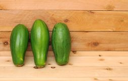 Three green papayas Royalty Free Stock Photo