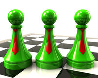 Three green pawns with red neckties Stock Photography