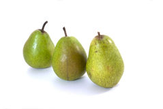 Three green pears. On a white background Royalty Free Stock Photos