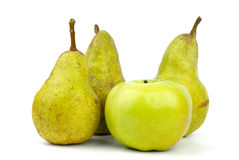Three green pears and apple Royalty Free Stock Photo