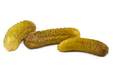Three green pickles on white background Stock Image
