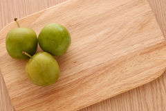 Three green plums Royalty Free Stock Photography