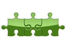 Three green puzzles Royalty Free Stock Image