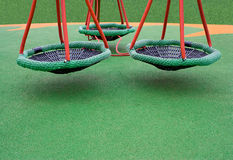 Three green swings Stock Image
