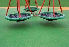 Three green swings stock image