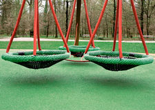 Three green swings together Royalty Free Stock Image