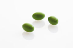 Three green tablets on white background Royalty Free Stock Photography