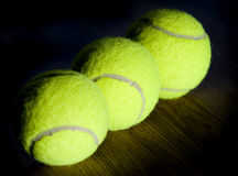 Three green tennis balls Stock Images