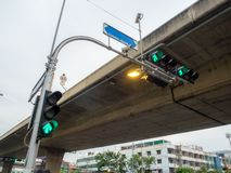 Three green traffic light at intersection in the city stock photography