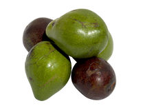 Three Green and Two Ripe Organic Avocado Pears Royalty Free Stock Images