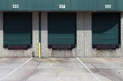 Three green warehouse loading bays. At industrial complex Royalty Free Stock Photos