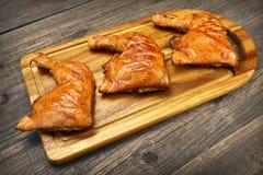 Three Grilled BBQ Chicken Leg Quarter On Wood Board Stock Photo