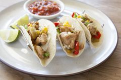 Grilled Chicken Tacos with Salsa and Lime. Three Grilled Chicken Tacos with Salsa and Lime royalty free stock photo