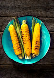 Three grilled corns Stock Photo