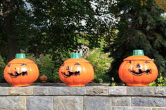 Three grinning Jack-O-Lanterns Royalty Free Stock Image