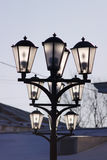 three ground lights on the town square, illuminated by the sun. Royalty Free Stock Image