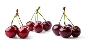 Three groups of juicy cherries. On white background royalty free stock photos