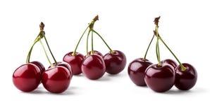 Three groups of juicy cherries Royalty Free Stock Photos