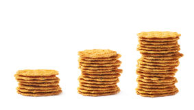 Three growing stacks of cookies Stock Image
