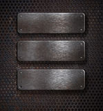 Three grunge rusty metal plates over grid stock images
