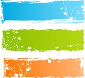 Three grungy multicolored banners with florals Royalty Free Stock Photos