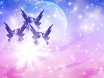 Three guardian angels. Three angels over pink blue angels with stars over blue pink backgrund with copy space Royalty Free Stock Photo