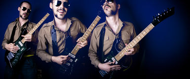 Three guitar players Stock Photos