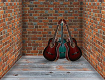 Three guitars in the corner of the room Stock Photos