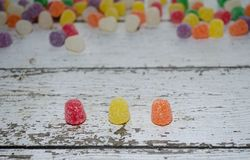 Three Gum Drops. With shallow depth of field More gum drops in back. Copy space royalty free stock photography