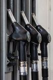 Three guns for refueling at the gas station Royalty Free Stock Photo