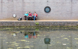 Three Guys Chatting Near Canal Stock Photos