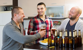 Three guys  at home Royalty Free Stock Photo