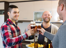 Three guys  at house party Stock Images