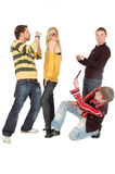Three guys take photo of a posing girl by a mobile. Isolated on white royalty free stock photo