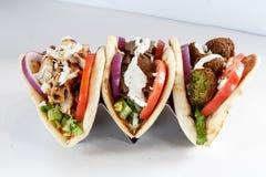 Three gyros. Chicken, Lamb and Falafel gyros Stock Image