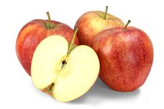 Three and half. Three ripe red apples and half of apple isolated on white background Royalty Free Stock Images